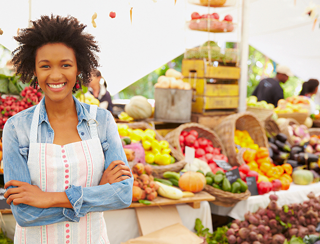 Woman standing in front of a farmer's market