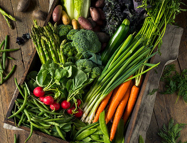 Crate of carrots, radishes, and beans